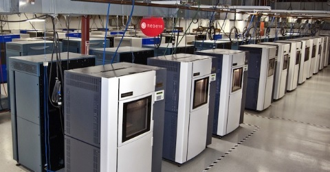 3D printers lined up in a manufacturing facility